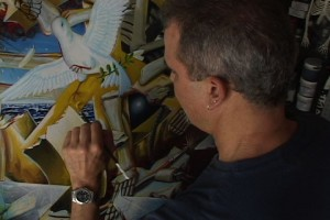 Gam Ramirez paints in his studio